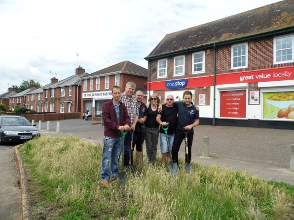 before the work began, group picture outside the One Stop Shop