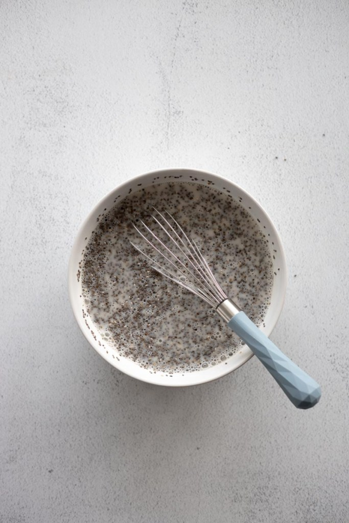 Chia seed pudding mixing in a bowl