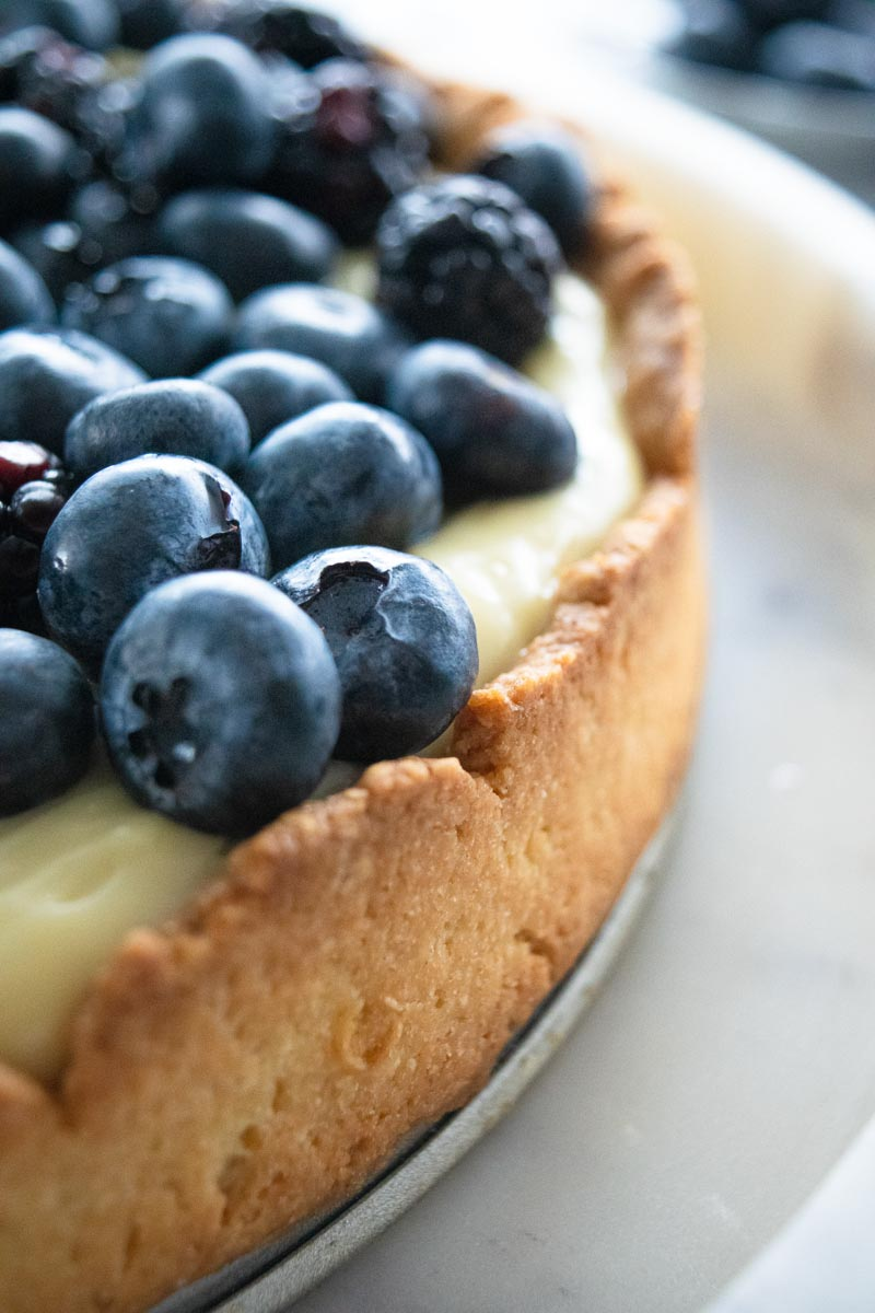 Close up of berry tart with almond press-in crust
