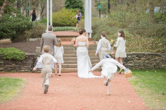 Bride and Groom walking away, kids running