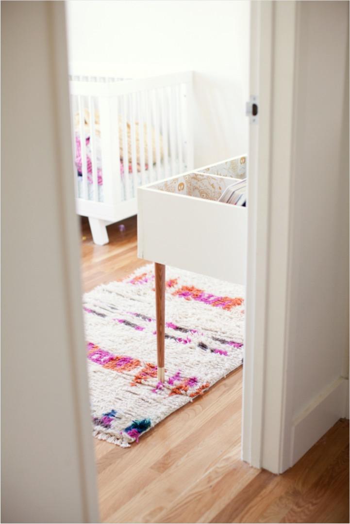 kids book bin and rug