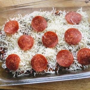 This upside down pizza casserole is the perfect family friendly keto dish! It's so easy to make and can even be prepped ahead of time for a quick weeknight meal!