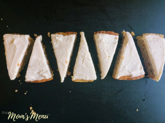 overhead view of Triangular slices of low carb carrot cake arranged on a black surface.