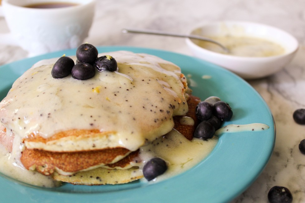 Take your pancake game to the next level with these delicious Lemon Poppy Seed Pancakes with a Creamy Lemon Sauce. They are perfect for a spring or summer breakfast and best of all - they are deceivingly simple to make.
