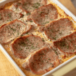 Cheesy spaghetti squash and pork chop casserole in a yellow casserole dish