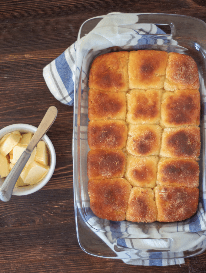 an overhead shot of keto Hawaiian sweet rolls with butter to the side.