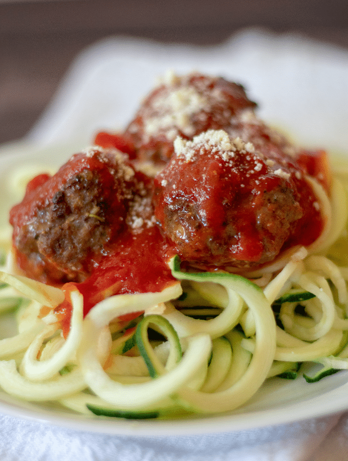Homemade meatballs and marinara on top of zucchini noodles