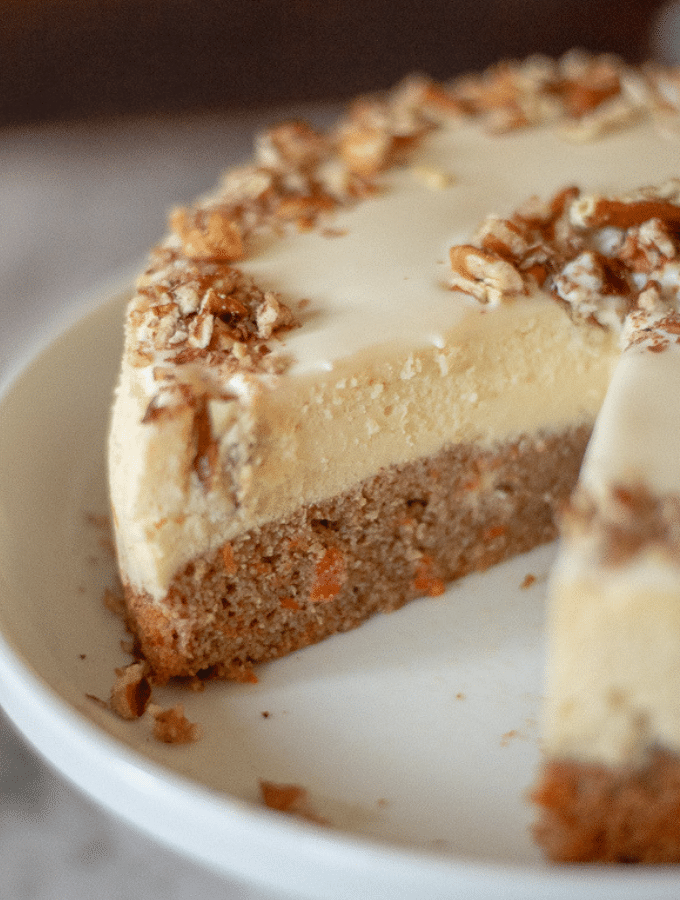 A keto carrot cake cheesecake with one slice removed