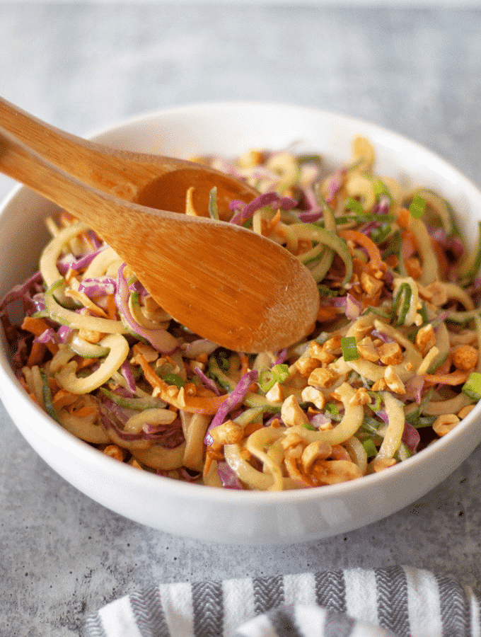 Low Carb sesame noodle salad in a bowl with wooden tongs