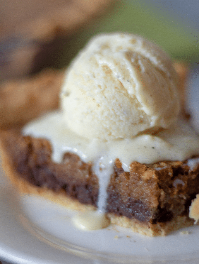 A slice of keto Kentucky Derby Pie topped with vanilla ice cream.