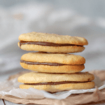 three keto milano cookies stacked on top of each other