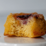 a close up shot of one low carb pineapple upside down cupcake with a bite taken