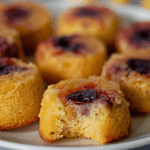 A plate full of low carb pineapple upside down cakes with one bite taken