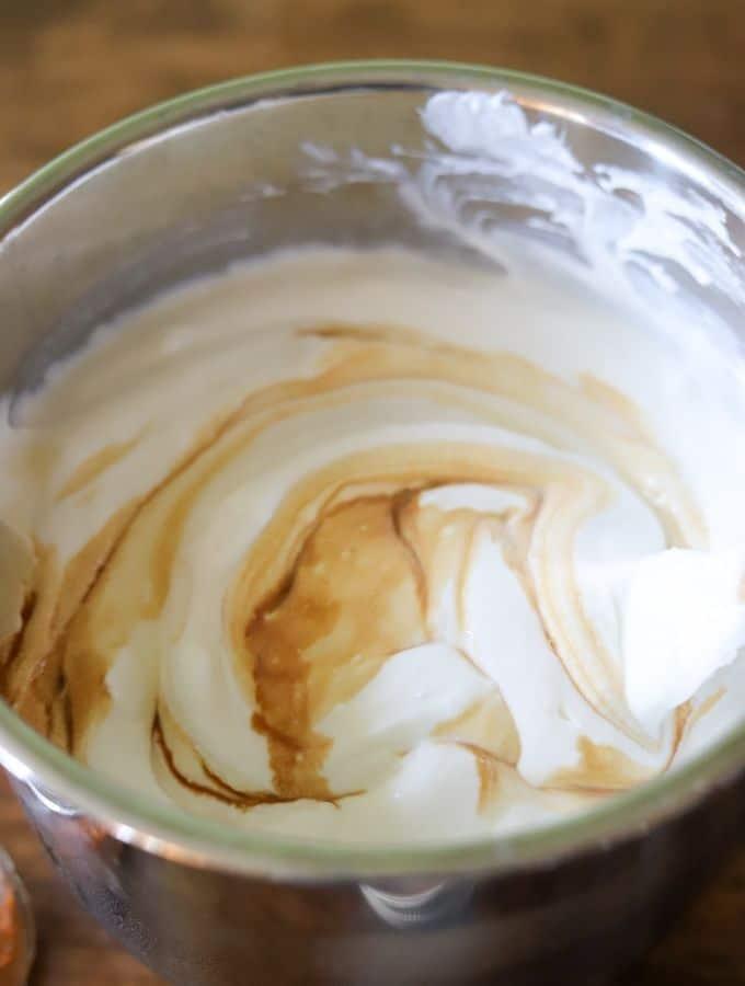 Homemade yogurt inside an instant pot, with swirls of vanilla extract