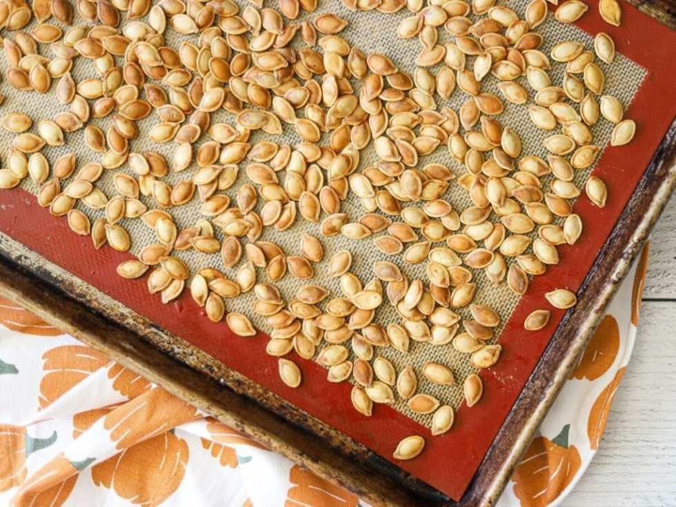 a sheet pan full of roasted pumpkin seeds