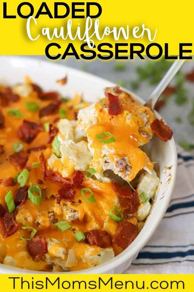 a white casserole dish full. of loaded cauliflower casserole topped with melted cheddar cheese, crumbled bacon, and diced green onions. The image has a text overlay.