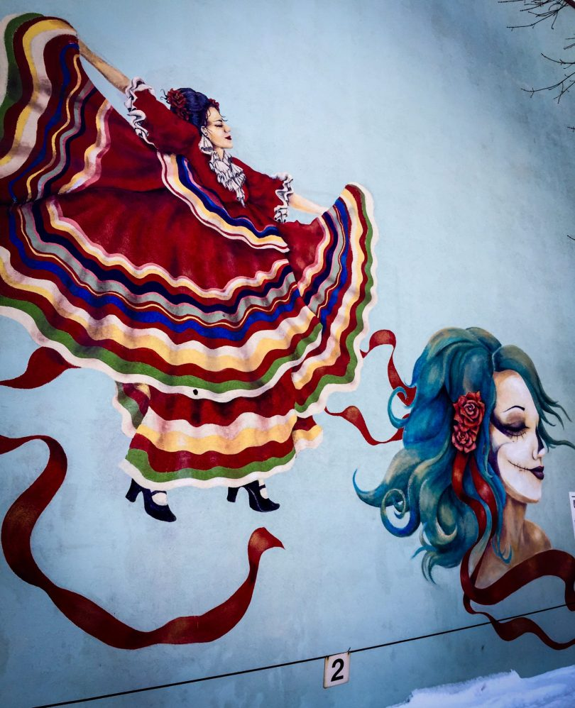 Mexican dancer and death mask mural