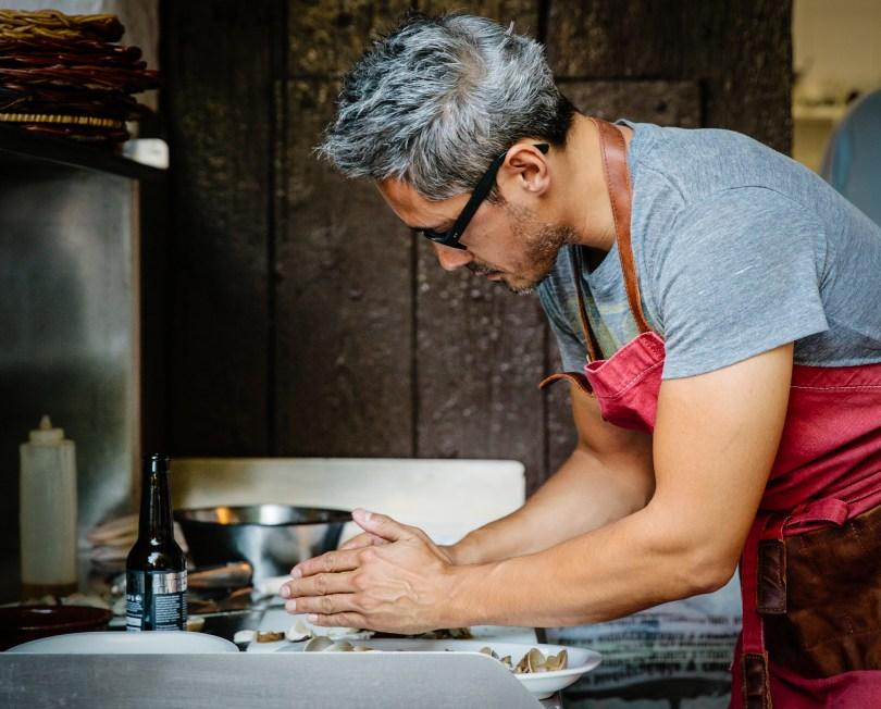 Kevin Patricio preparing a meal