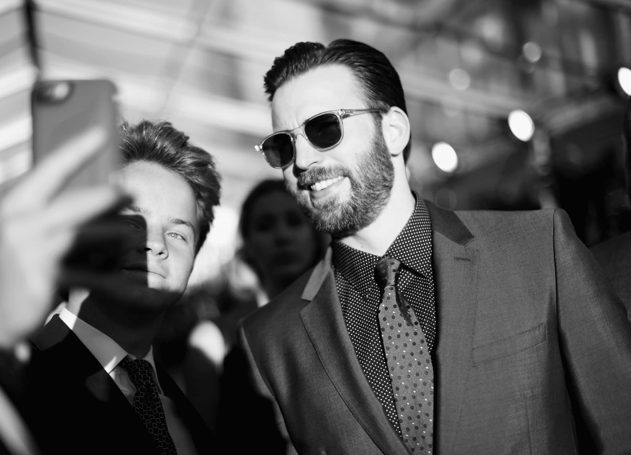 """HOLLYWOOD, CALIFORNIA - APRIL 12: (EDITORS NOTE: Image has been shot in black and white..Color version not available.) Actor Chris Evans takes a selfie at The World Premiere of Marvel's """"Captain America: Civil War"""" at Dolby Theatre on April 12, 2016 in Los Angeles, California. (Photo by Charley Gallay/Getty Images for Disney) *** Local Caption *** Chris Evans"""