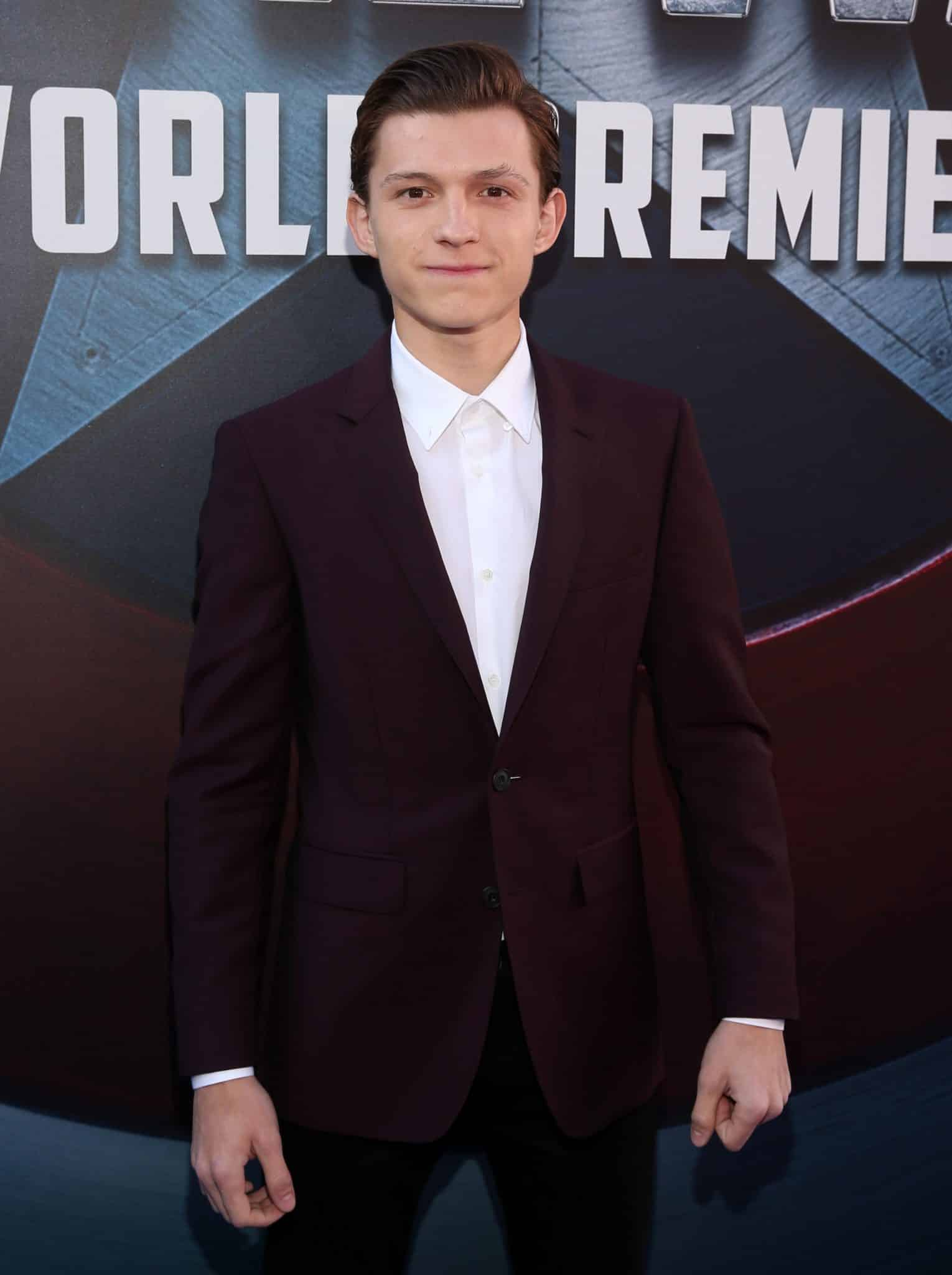 """HOLLYWOOD, CALIFORNIA - APRIL 12: Actor Tom Holland attends The World Premiere of Marvel's """"Captain America: Civil War"""" at Dolby Theatre on April 12, 2016 in Los Angeles, California. (Photo by Jesse Grant/Getty Images for Disney) *** Local Caption *** Tom Holland"""