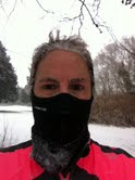 30 something mother runner in the snow