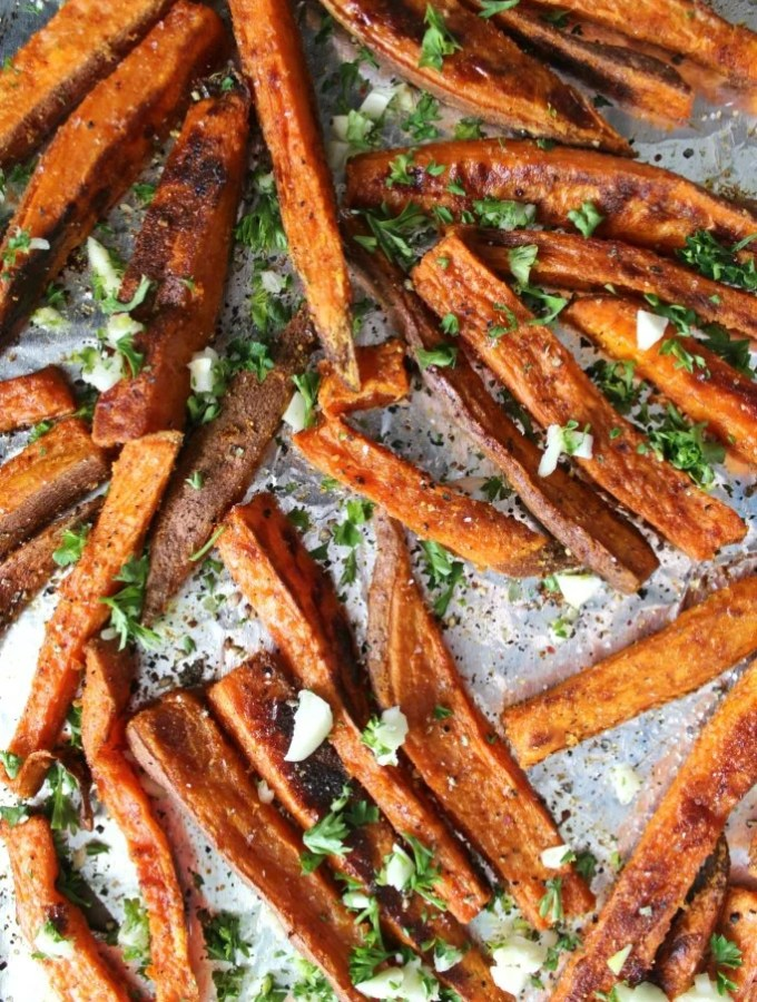 These Baked Garlic Sweet Potato Fries are a guilt free treat | VEGAN + GF | ThisSavoryVegan.com