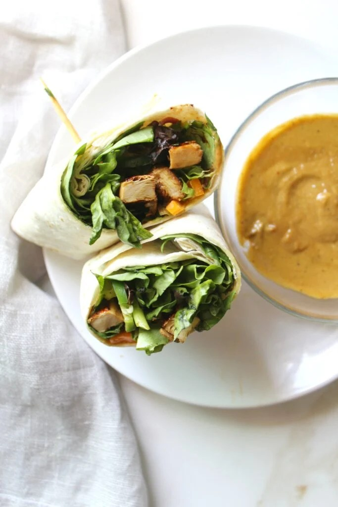 This Asian Chick'n Wrap with Spicy Tahini Sauce is an easy VEGAN lunch | ThisSavoryVegan.com