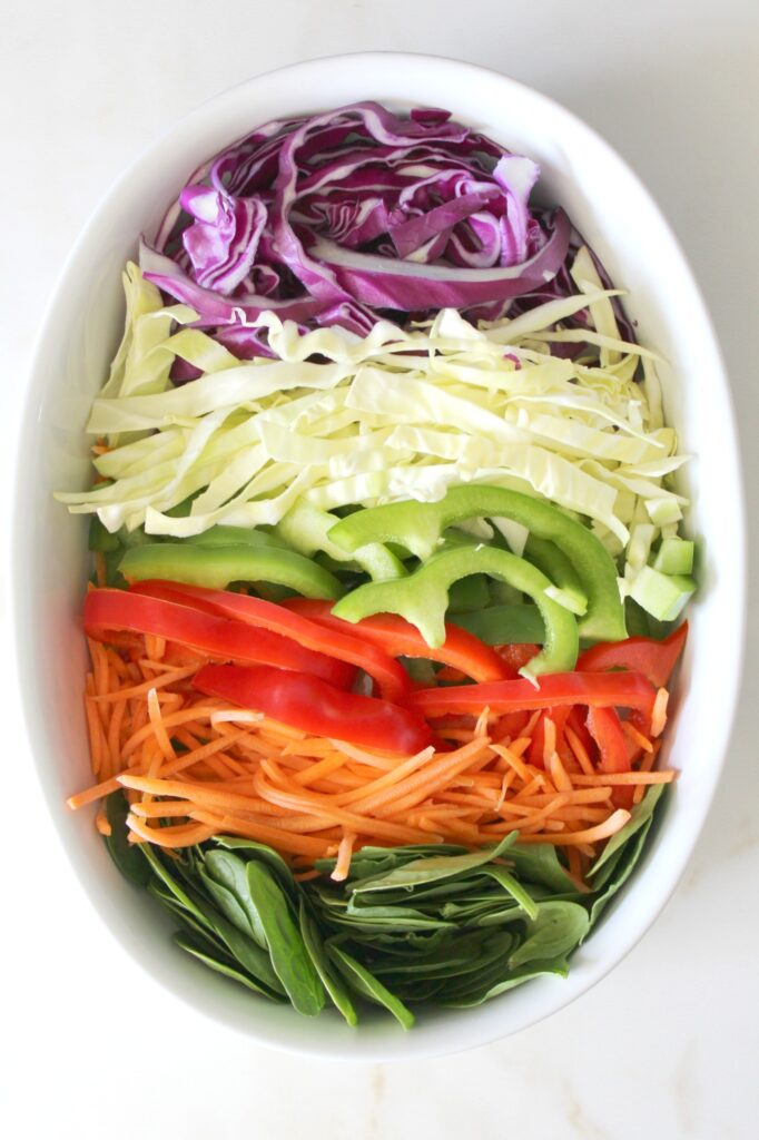 This Pad Thai Veggie Salad is packed with lots of veggies and topped with a creamy Spicy Peanut Sauce   VEGAN + GF   ThisSavoryVegan.com