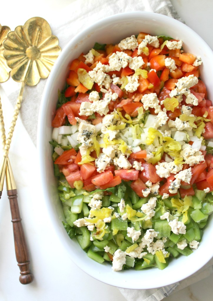 This Chopped Salad with Tofu Feta combines tons of veggies with a tangy dressing and faux feta | VEGAN + GF | ThisSavoryVegan.com