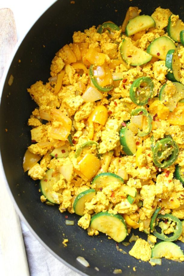 """This Tofu Veggie Scramble is the perfect healthy breakfast - veggies are sautéed with protein packed tofu and the """"miracle"""" seasoning turmeric   ThisSavoryVegan.com"""