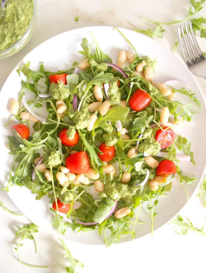 This Arugula White Bean Salad is topped with the best pesto/chimichurri dressing ever! | VEGAN + GF | ThisSavoryVegan.com