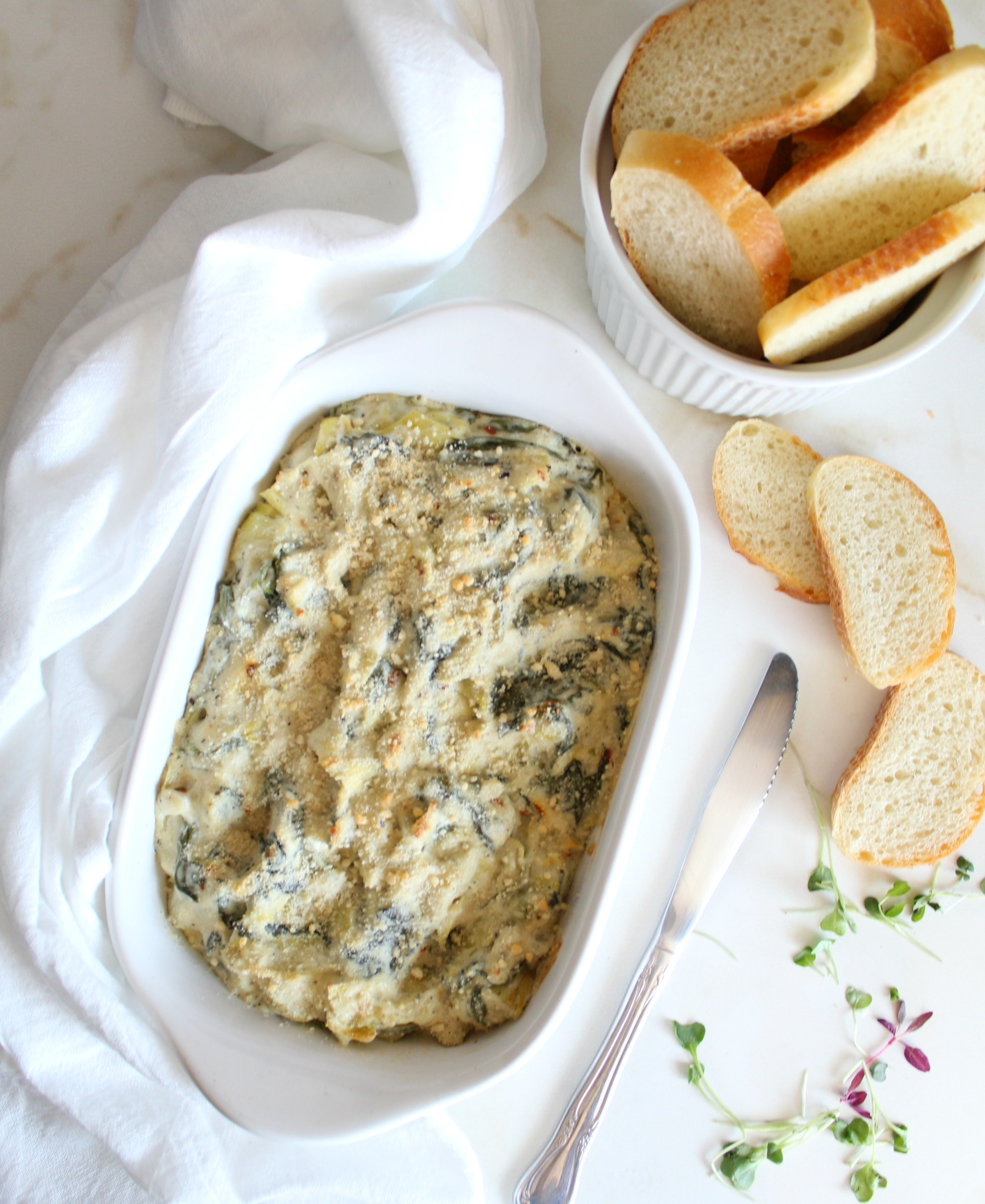 This Vegan Baked Spinach Artichoke Dip is creamy, cheesy and yes, it's vegan!   ThisSavoryVegan.com