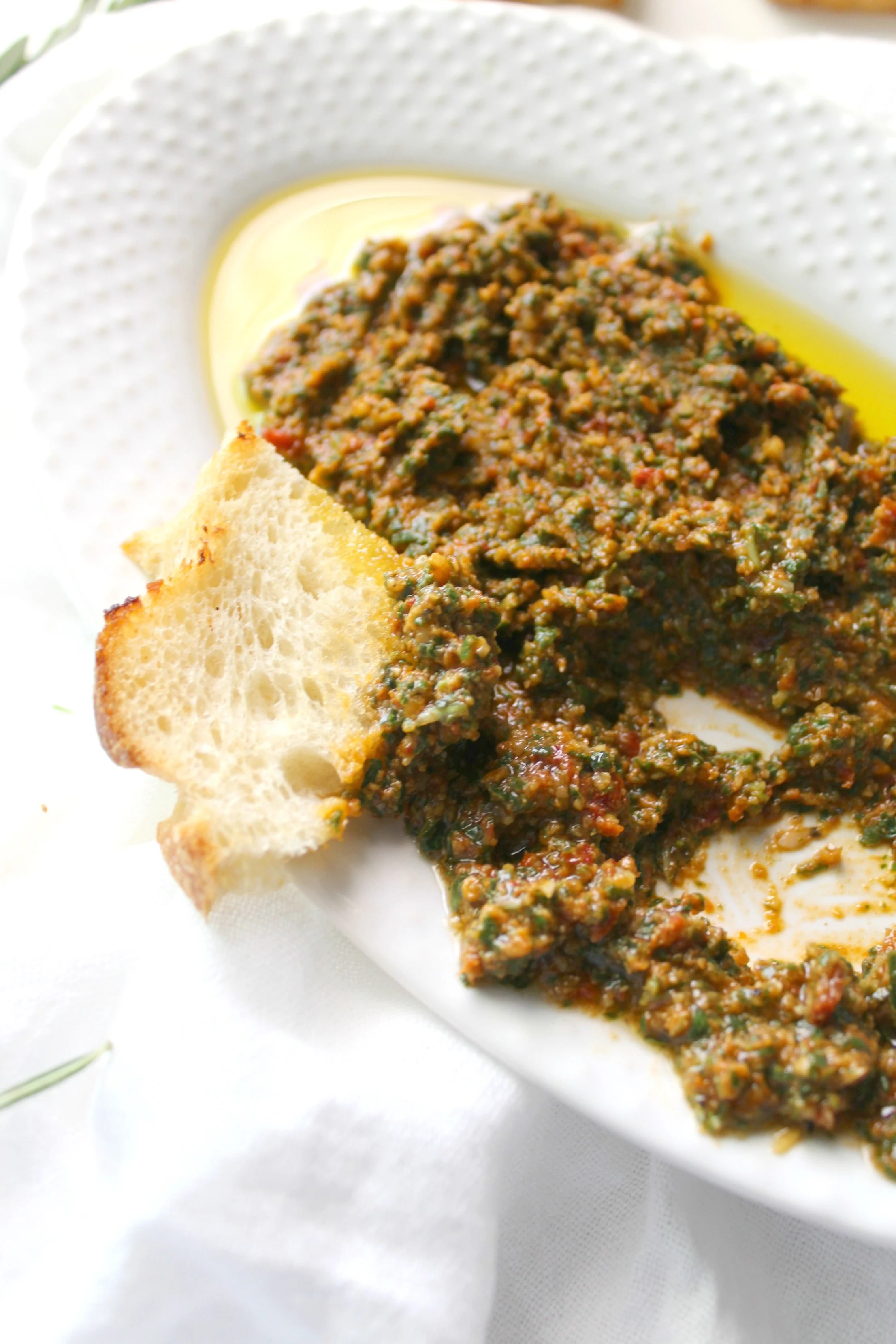 This Simple Vegan Mediterranean Spread is filled with fresh herbs and sun-dried tomatoes and can be served on sandwiches, as a dip or even with pasta | ThisSavoryVegan.com