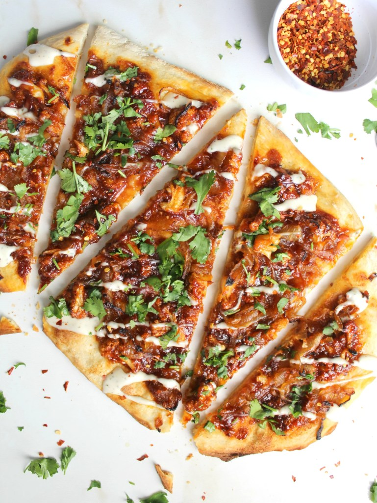 One of the best pizza combos is vegan-zed with this Vegan Roasted Cauliflower BBQ Pizza - perfect Friday night eat!   ThisSavoryVegan.com
