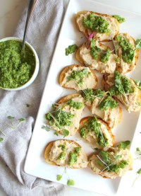 This White Bean Crostini with Pesto is savory and bright. Made with tons of fresh herbs this is sure to be the ultimate crowd pleaser | ThisSavoryVegan.com