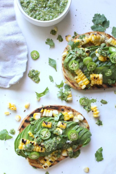 Spice up your next brunch with this Serrano Pepper Avocado Toast - packed full of flavor with grilled corn and fresh chimichurri sauce | ThisSavoryVegan.com
