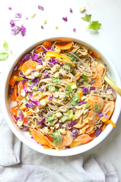 Keep dinner light and healthy with this Soba Noodle Salad with Peanut Dressing. Ready in less than 30 minutes and packed full of delicious veggies | ThisSavoryVegan.com