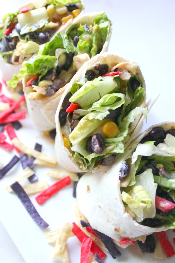 Keep things cool and easy with these Southwest Veggie Wraps with Vegan Ranch. A super simple lunch or dinner packed full of veggies and lots of flavor! | ThisSavoryVegan.com