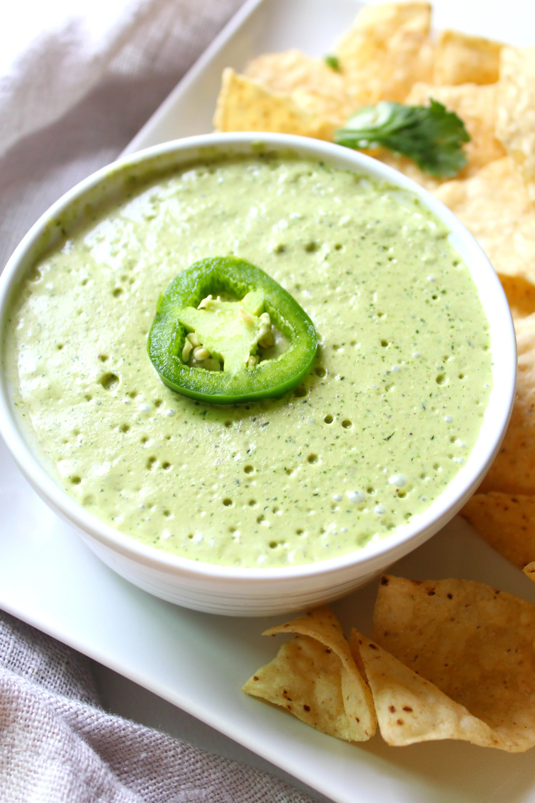 The perfect addition to tacos, nachos or enchiladas - this Vegan JalapeñoCream Sauce is packed full of flavor and heat   ThisSavoryVegan.com
