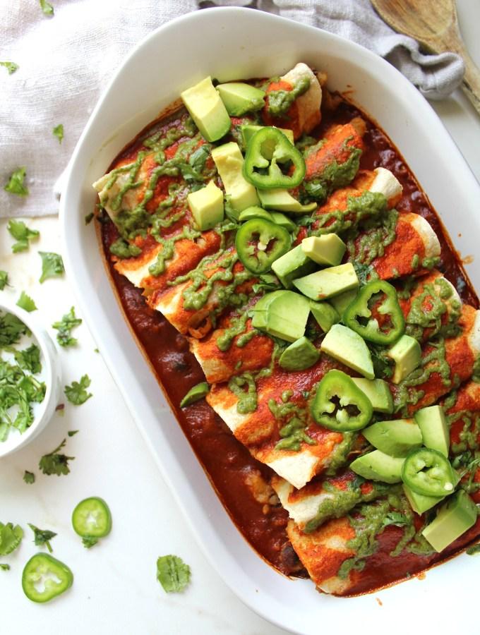 Simple and delicious, theseBlack Bean Potato Vegan Enchiladas with Avocado Cilantro Sauce are the perfect weeknight dinner!   ThisSavoryVegan.com