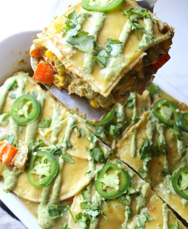 ThisVegan Enchilada Casserole with Jalapeño Cream Sauce is the perfect make ahead meal for busy weeknights or Sunday meal prep | ThisSavoryVegan.com