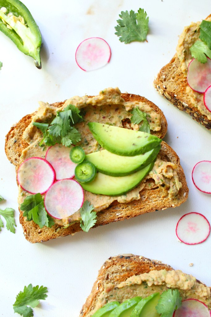 This Smashed Bean and Avocado Toast is next level. The perfect healthy vegan snack - packed full of mexican flavors and nutrient-rich ingredients | ThisSavoryVegan.com #vegan #healthyvegan