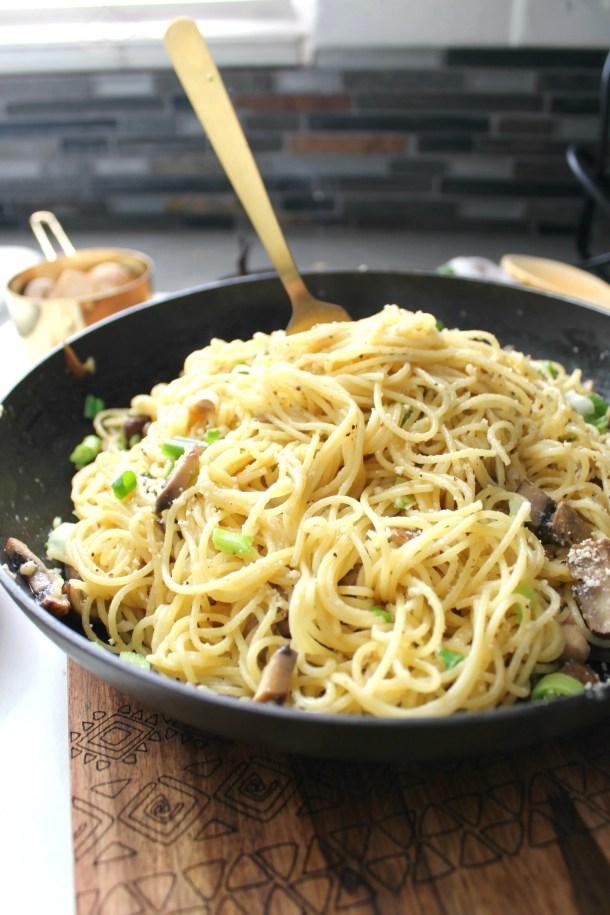 Simple and delicious, these Vegan Mushroom Garlic Parmesan Noodles are a delicious mix of angel hair pasta, sliced mushrooms, fresh garlic and parmesan   ThisSavoryVegan.com #vegan #veganrecipes