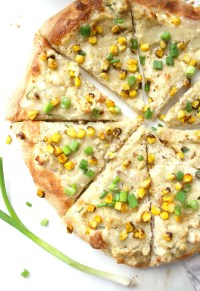 This Vegan Mashed Potato White Pizza is the ultimate comfort food. Creamy white base, mashed potatoes, fresh corn and savory gravy on top of crispy crust | ThisSavoryVegan.com #vegan #veganpizza