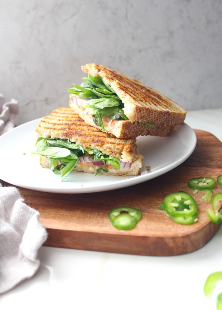 ThisVegan California Panini is packed full of avocado, red onion, tomato, jalapeño, cilantro, spinach and vegan cream cheese   ThisSavoryVegan.com #vegan #simplevegan
