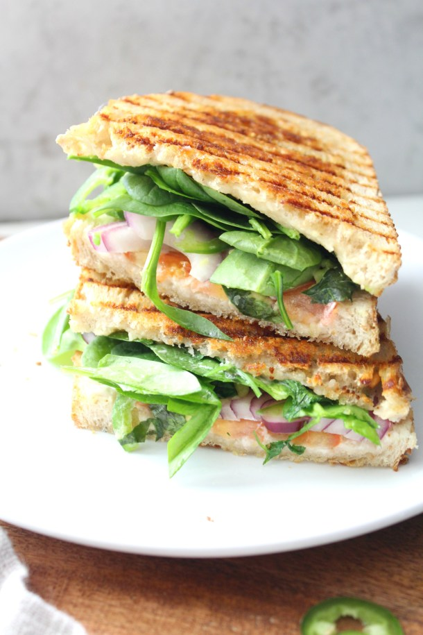 This Vegan California Panini is packed full of avocado, red onion, tomato, jalapeño, cilantro, spinach and vegan cream cheese | ThisSavoryVegan.com #vegan #simplevegan