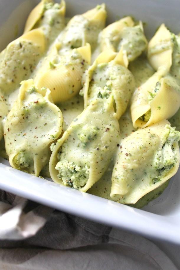 Have a fancy dinner with minimal work -Vegan Ricotta Stuffed Shells with Creamy Pesto. A baked pasta dish that everyone will love | ThisSavoryVegan.com #vegan #veganpasta