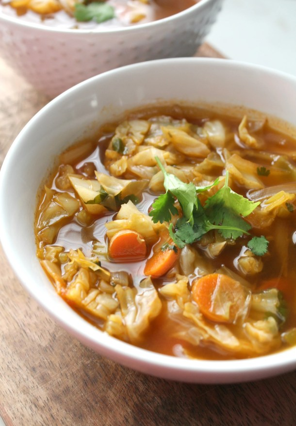 Perfect for those cold winter days, this Spicy Cabbage Detox Soup is packed full of veggies, spices and a delicious vegan beef broth | ThisSavoryVegan.com #vegan #vegansoup
