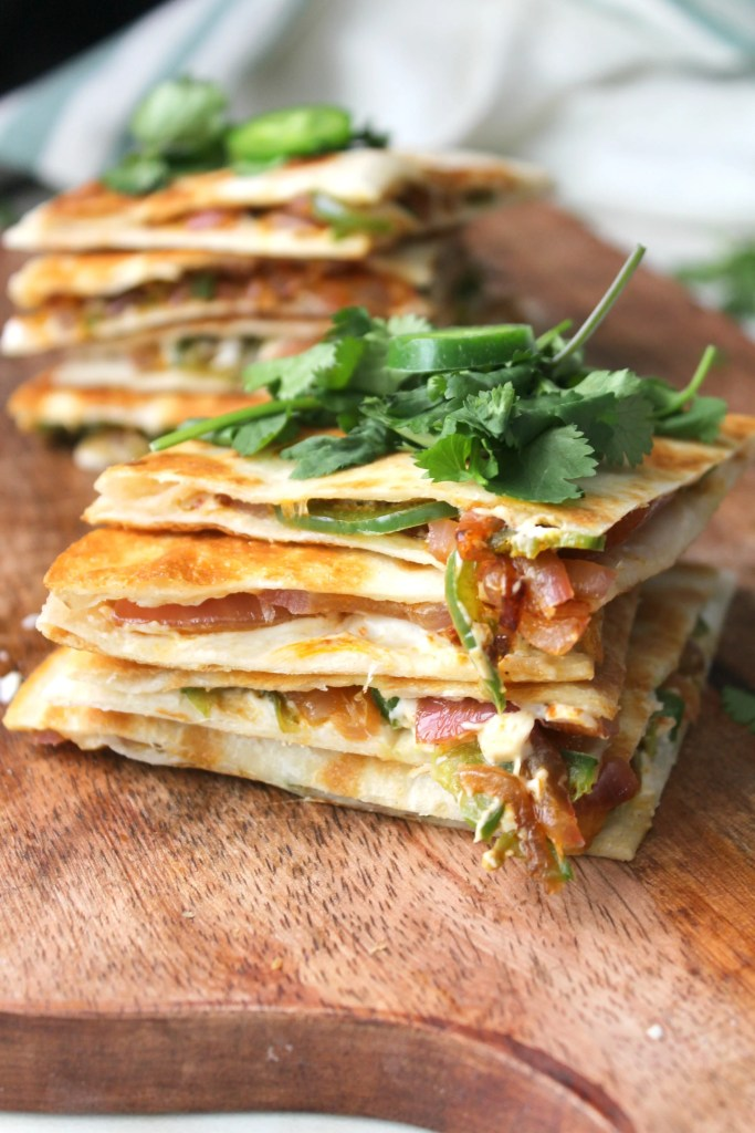The simple way to get all of the flavors of jalapeño poppers with minimal work. These Vegan Jalapeño Popper Quesadillas are creamy, crunchy and a little spicy | ThisSavoryVegan.com #vegan #gameday