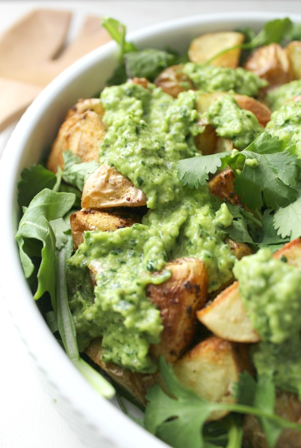 This Vegan Spring Potato Salad with Creamy Dreamy Green Sauce is traditional potato salad's lighter, greener and tastier cousin. Warm garlicky potatoes are tossed with fresh arugula and a green sauce that is packed with flavor | ThisSavoryVegan.com #vegan #spring #potatosalad